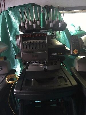 Two Melco Amaya XT Embroidery Machines