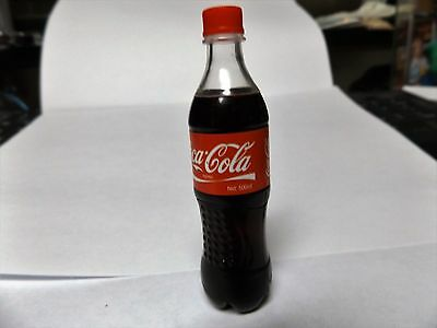 Coke bottle refillable butane lighters. Coco- cola bottle shaped refillable