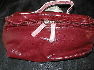 COSMETIC POUCH, with zipper closure & fully lined. Burgundy w pink handle strap