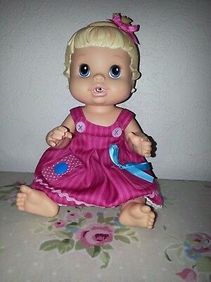 Doll Baby Alive Drinks and wets with pants and dress