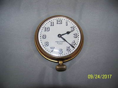 Waltham car or travel clock 37 Size 8 day enamel dial spade hands runs nicely!
