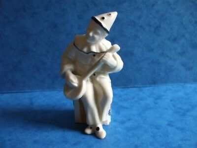 Crested china figure pierrot playing a banjo