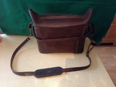 Camera and accessory case with shoulder strap