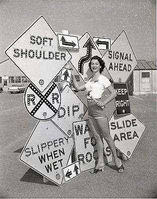 "MD62-038  '56 SEXY GAL HAMMERS A STREET SIGN IN GROUPING 4""x5"" ORIGINAL NEG."