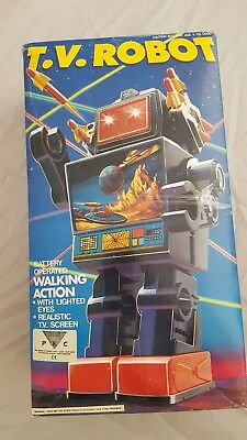 vintage TV robot with walking action battery operated. Rare. 1970's 1980's Boxed