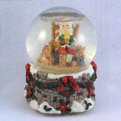 Snow Globe Holiday Glass Christmas Santa in a chair with animals around