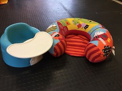 Bumbo with tray and inflatable support ring.