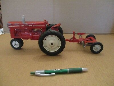 Tru-Scale tractor and farm implement