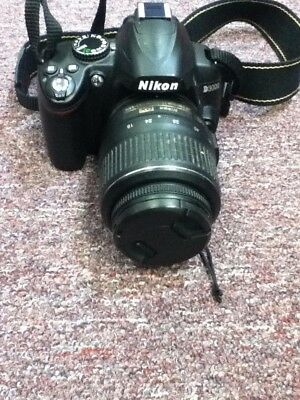 Nikon Digital Camera D3000 with charger lens and carrying bag