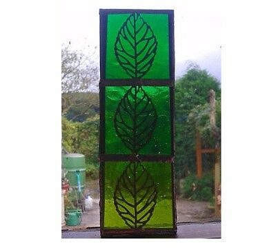 STAINED GLASS LEAF SUNCATCHER.  Handmade by The Stained Glass Panel Studio.