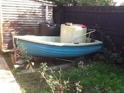 Small fibre glass dinghy with outboard and Oars