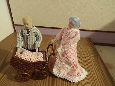 Dolls House grandmother and grandad  pushing baby in pram  1.12