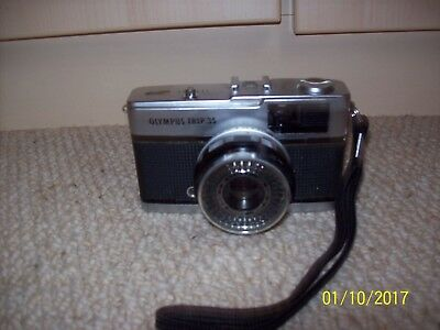 An OlympusTrip 35 vintage camera with case and instruction book