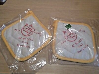 TWO - REDDY KILOWATT magnetic Pot Holders sealed package w/ paper inserts