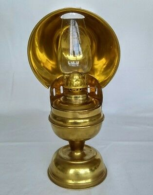 Vintage brass oil lamp with glass chimney and reflective hood