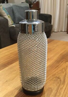 Vintage Glass Cocktail Shaker wIth Wire Mesh Decor, Mounting is Chrome-plated.