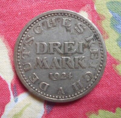 German Drei Mark 1924 coin.