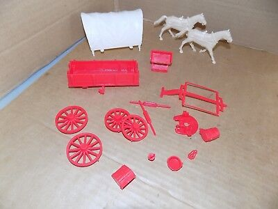 Marx recast red covered wagon with top, and horses plus accessories
