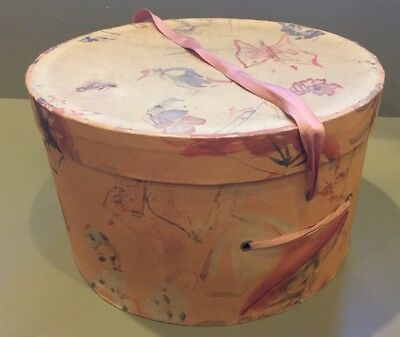 """Vintage women's peach color pattern hat box with ribbon cord 11""""dia x 7"""""""