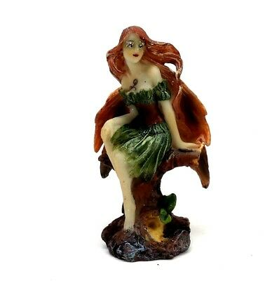 Small Fairy With Orange Wings in a Green Dress Figurine Mythical Fantasy Statue