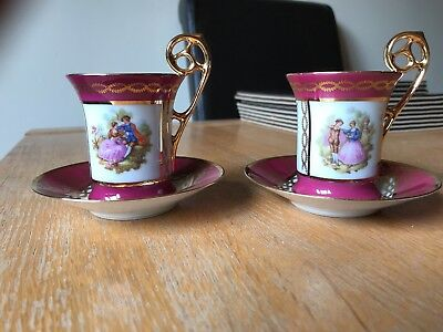 A pair of Limoges Cup Saucers