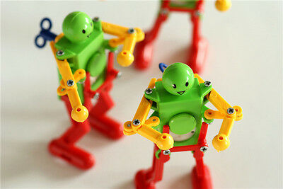 Real Ritzy Child Plastic Clockwork Spring Wind Up Dancing Robot Toys Gift gi