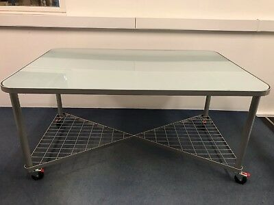 Modern glass desk perfect for office or home office.