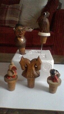 5 vintage ? Anri,? Black Forest bottle stoppers
