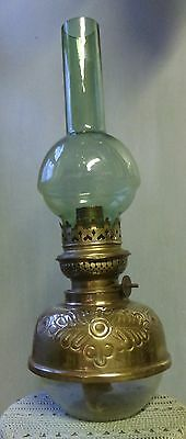 Victorian brass paraffin oil lamp with unusual green glass chimney