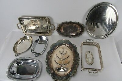 Lot of 9 Silverplate and other assorted serving pieces.