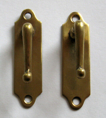 Pair of Victorian reclaimed brass hooks/blind cord stays.  3 ins long.
