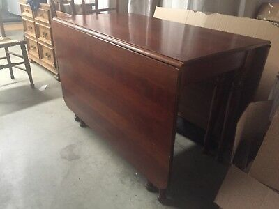 "Antique solid cherry gate leg table. Top measures 27 x 44"". +2 drop leafs same"