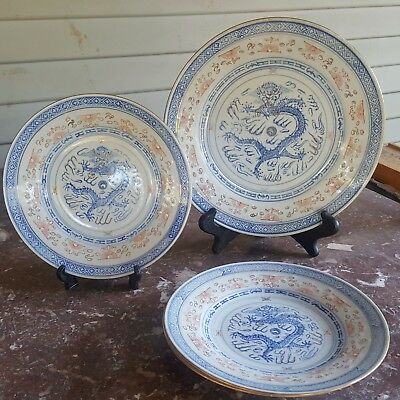 Set of four multi colored Chinese rice grain plates dragon decoration