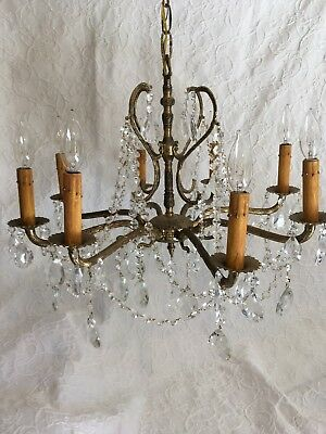 "Antique Brass and Crystal Chandelier Eight light. 24""X 24'X16""X' New wiring"