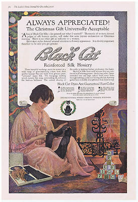 1916 BLACK CAT Silk Hosiery Lady Next to Fireplace on Christmas Color Print Ad