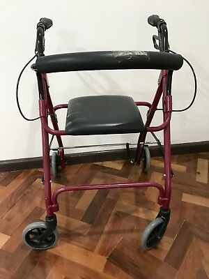 Mobility Walker With Wheels And A Seat In Great Condition