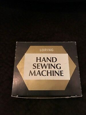 Vintage Loring Plastic Hand Held Sewing Machine with Box and instructions
