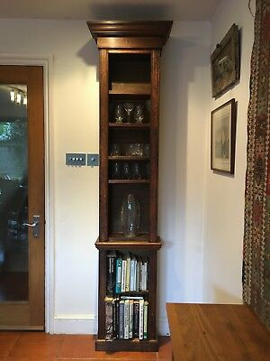 Antique oak bookcase mounted in grandfather clock casing