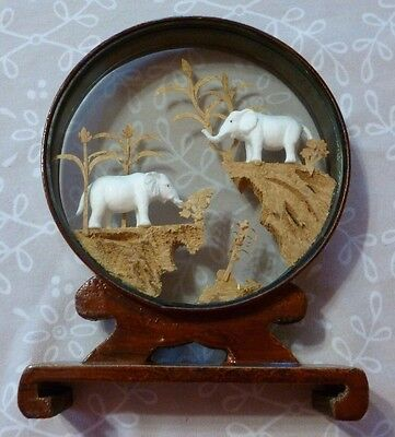 Carved 3-D Scene with Elephants Framed in Double sided glass