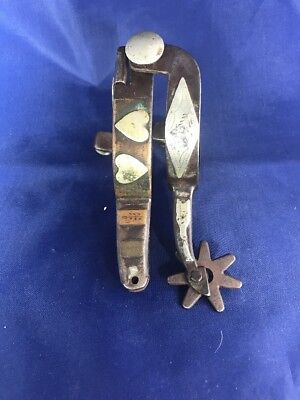 2 Single Kelly Bros Spurs, One Marked Heart Pattern, the Other Unmarked