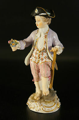 Very Unique Antique Meissen Figurine Boy with a Shovel and Flowers.