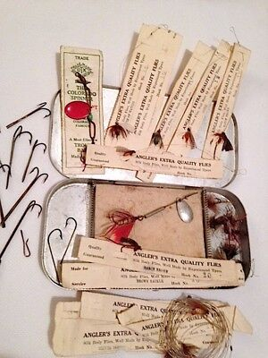 Vintage aluminum fly box with many carded flies, minnow spear hooks,
