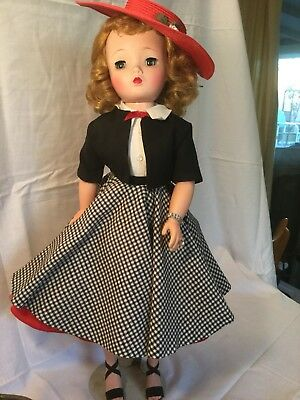 Vintage Madame Alexander Cissy doll in tagged clothing