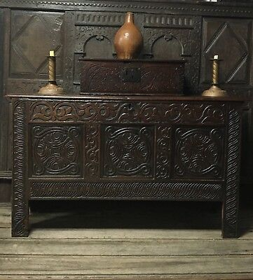 A Wonderful Mid 17th Century Carved Oak Coffer Of Transitional Form.