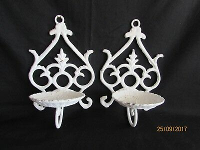 A Pair of Vintage Ornate Cast Iron Wall Mount Candle Holders