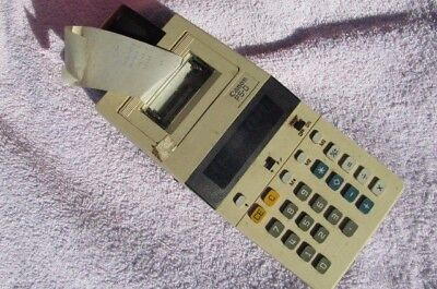 Vintage miniture  electric calculator with tape