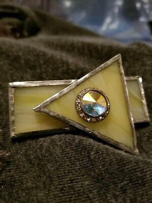 Art Deco stained glass brooch/pin. Yellow with rainbow quartz center.