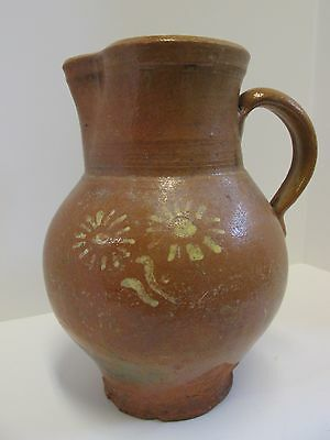 antique redware pitcher  European with yellow slip flowers