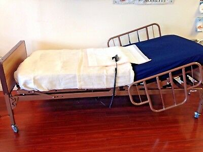 Tuffcare full electric hospital bed with mattress and half rails