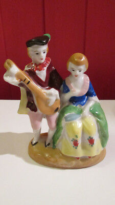 Made in occupied japan small porcelin figure musician with girl good condition